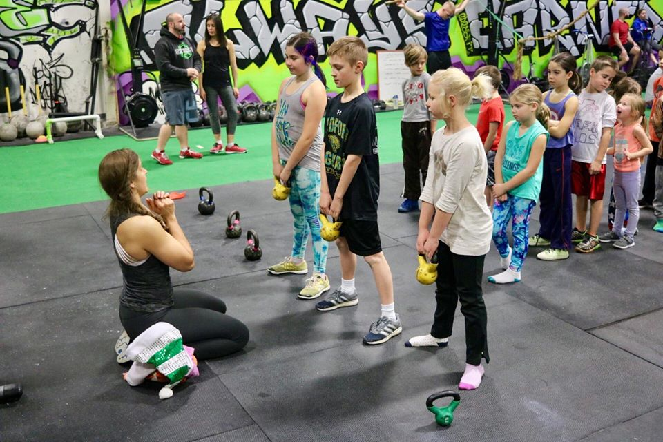 Jennifer begging.. err... coaching the littles on how to smash WOD's.