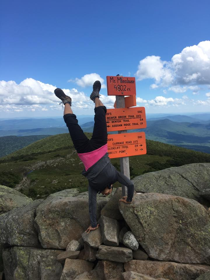 Regina getting all handstandy on the summit of Moosilauke.