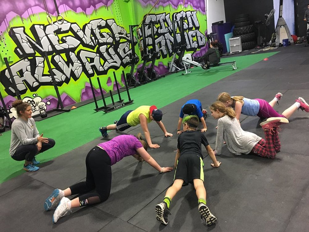 Kids learning not to forget your bottom half when doing push ups ;) they're getting there!