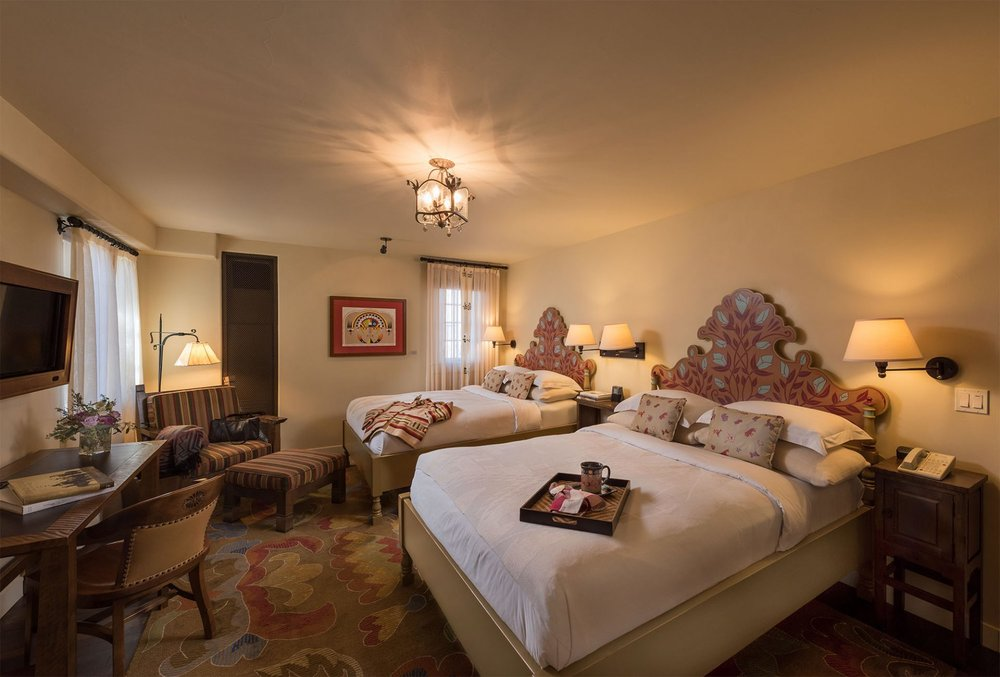 Your Deluxe Room with Fireplace at La Fonda on the Plaza has two Queen beds. A limited number of King rooms are available too.Bring a friend or we will match you up with a roommate. Ask about a single room option.