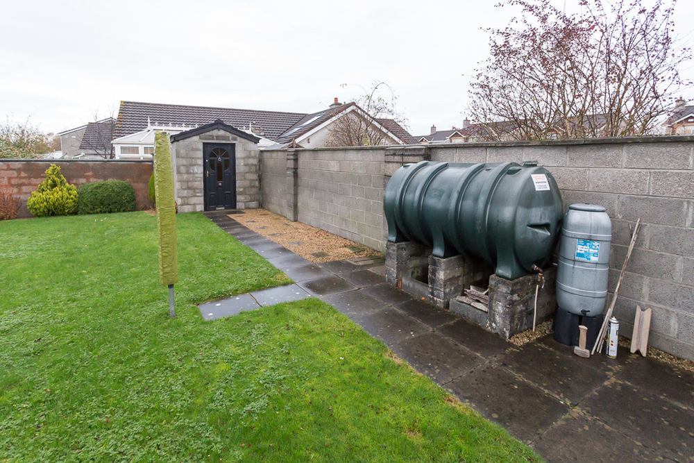 Oil tanks while a necessity are often unsightly. A robust utility area was to be constructed to conceal and hide the tank and refuse bins.