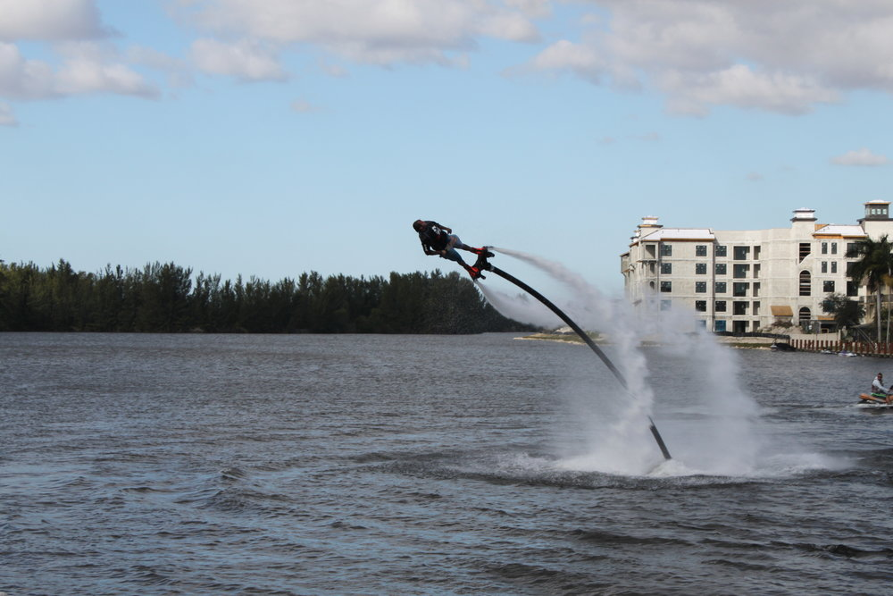 "This is a hydroflight athlete competing in Pompano Beach, Florida. Notice the water streams? He's doing an ""on-axis"" spin while diving into the water. Fixed boards are not capable of this type of maneuver. We will teach you a beginner level spin (depending on your comfort and skill level) about halfway into your first flight."