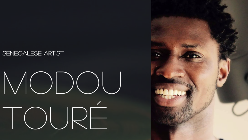 Modou Toure Headshot.png