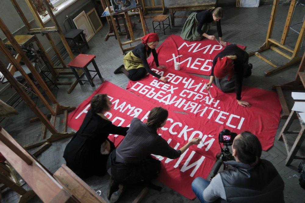 REVOLUTION Banner Painting.  Photo © www.foxtrotfilms.com.jpeg