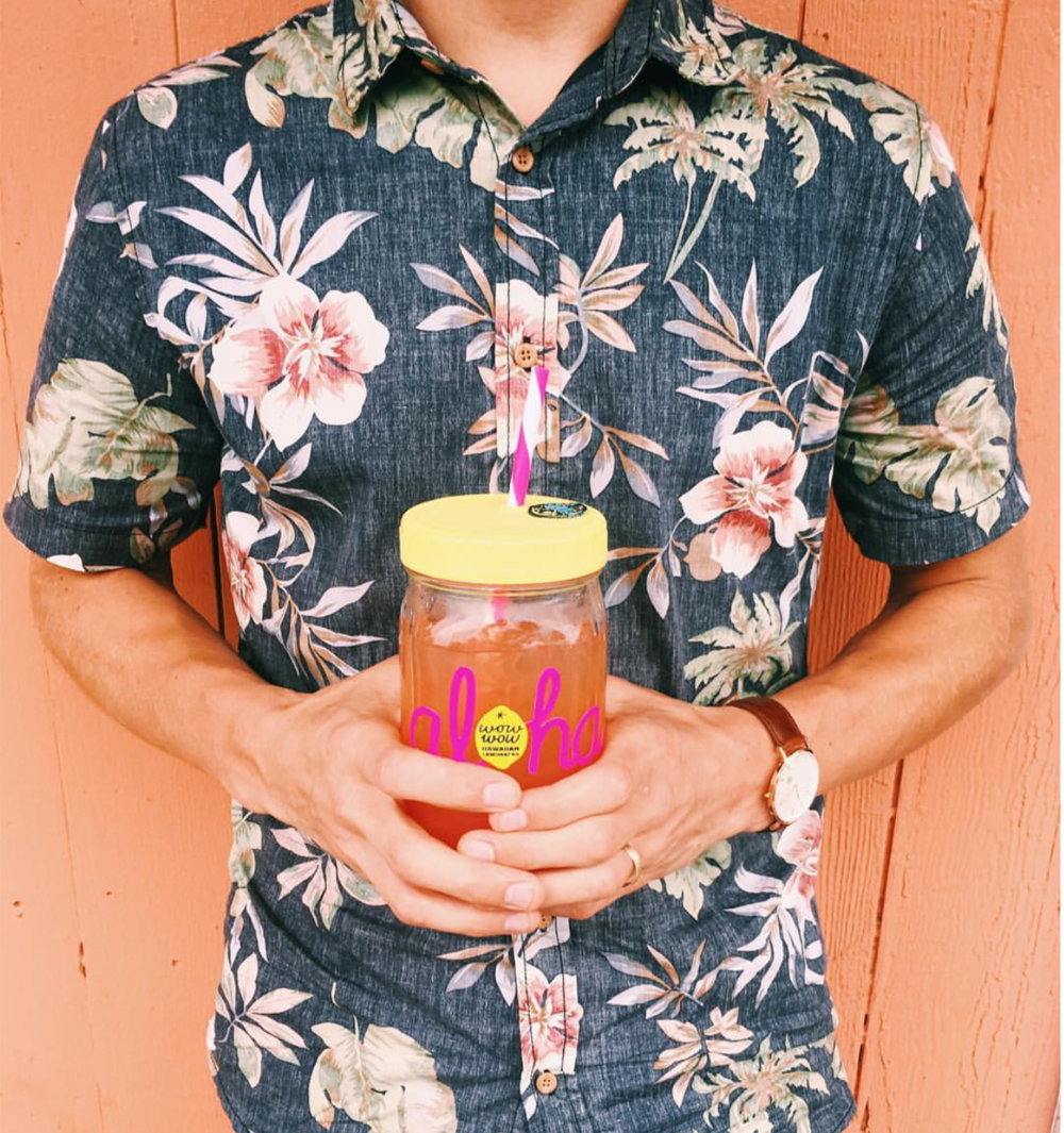 Go tropical with this button-up…and a drink in hand.