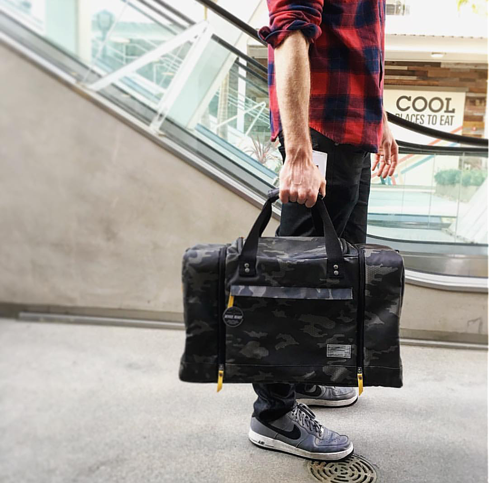 Whether camping or on vacay, this sneaker duffle bag by HEX is the perfect gift for a dad on the go!