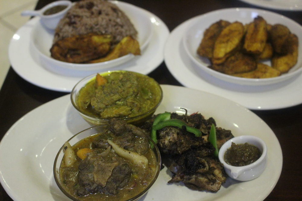 oxtail, curry chicken, curry goat and jerk chicken with rice and peas Jamrock