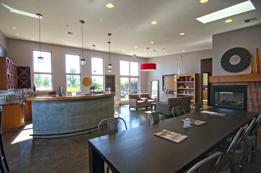 Our Walla Walla tasting room: a vineyard view and comfortable seating.