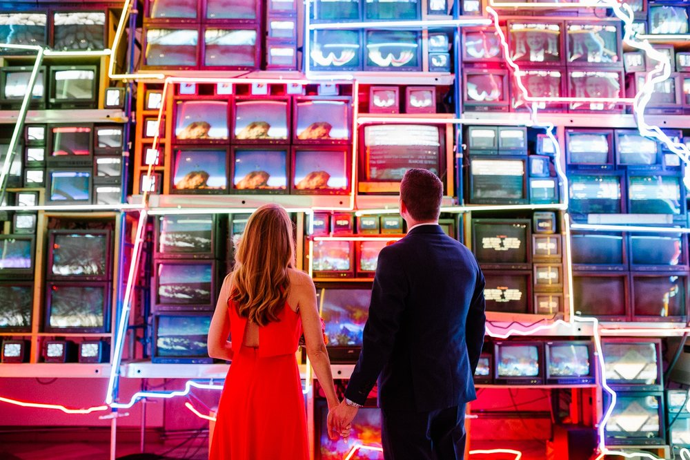 "Couple in front of ""Electronic Superhighway"" by Nam June Paik, an installation at The National Portrait Gallery."