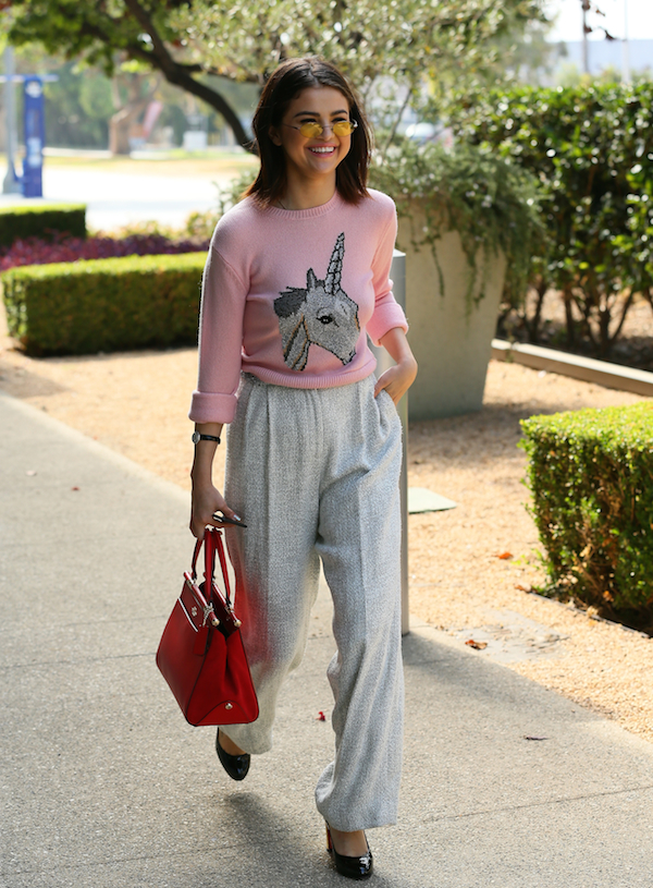 Selena Gomez spotted out in LA yesterday wearing the adorbs COACH Unicorn Sweater and her Selena Grace bag. Photo credit: JB Lacroix/Wireimage.
