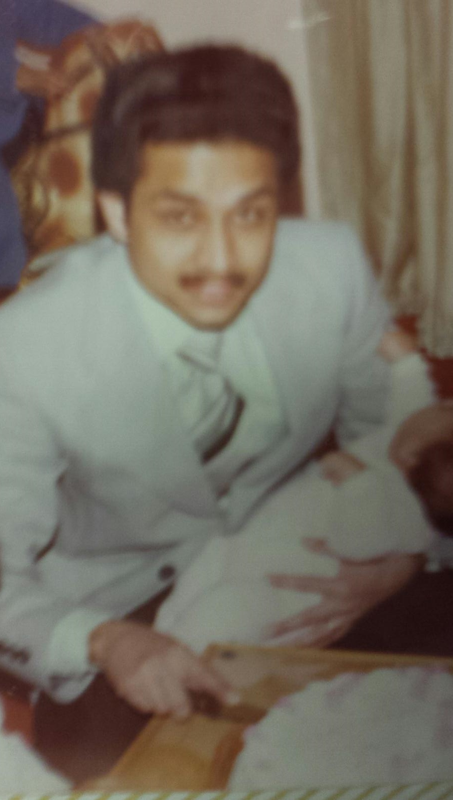 He will very likely end me if he finds out this picture is on the internet, but seriously people: check out that swagger. Dude is holding an infant and cutting a cake like it's NBD. I'd have trouble doing one of those things with total confidence.