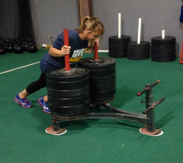 Michelle pushing 600lbs on the sled!