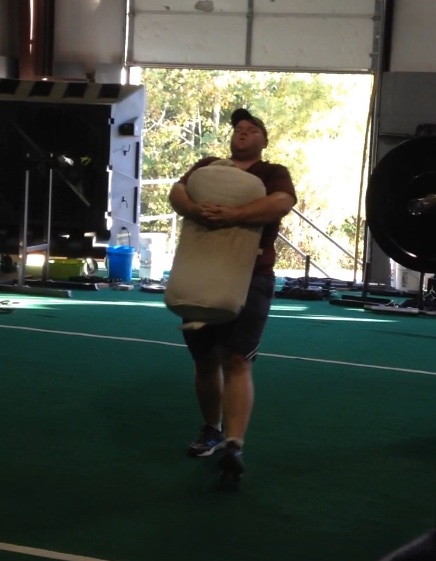 Robert showing off his brute strength with a 150lb sandbag carry!