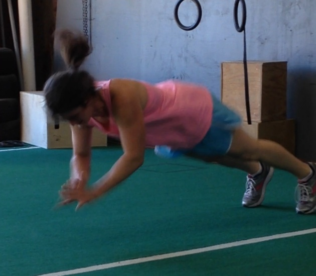 Ginnie getting some air on clapping push ups!