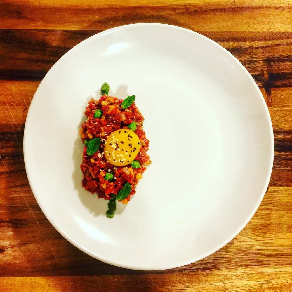 Steak tartare, gochujang, Asian pear, sesame oil, yuzu juice, mint and scallion sauce.
