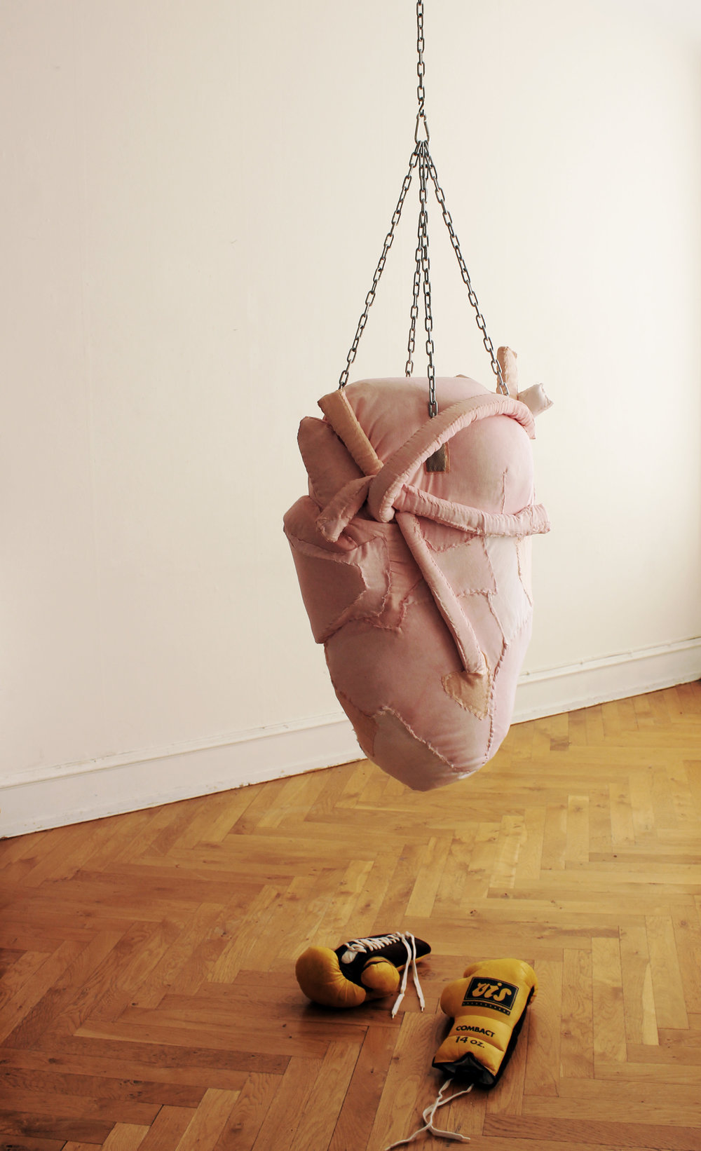 Organ heart punchbag. 2017  Textile,embroidery,iron chain,boxing gloves.  70x40x50cm
