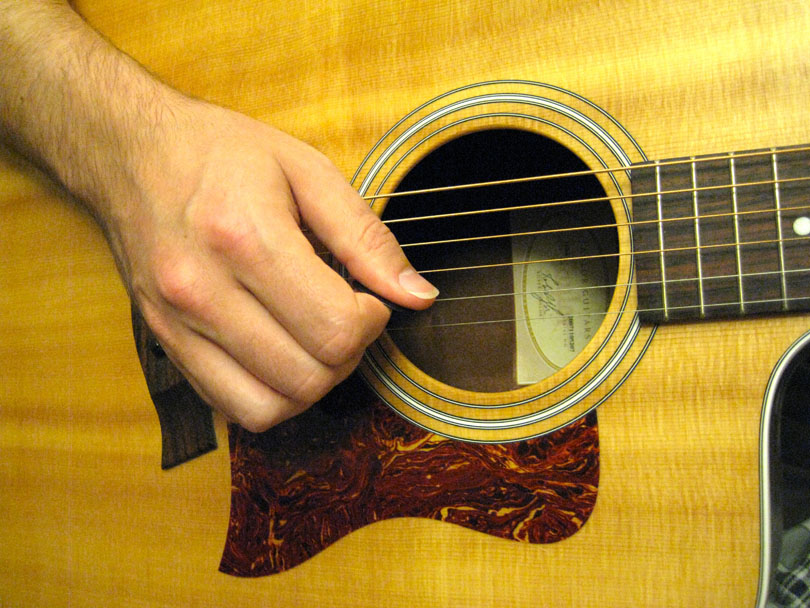 Keep the fingers of your picking hand together to increase volume.