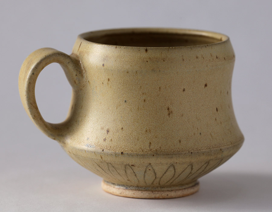 Mug, 2015. Wheel thrown stoneware, black inlay, reduction fired to cone 9.