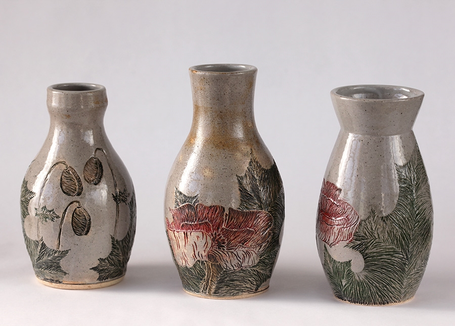 Poppy Vases, 2015. Wheel thrown stoneware, carved and stained, reduction fired to cone 9.