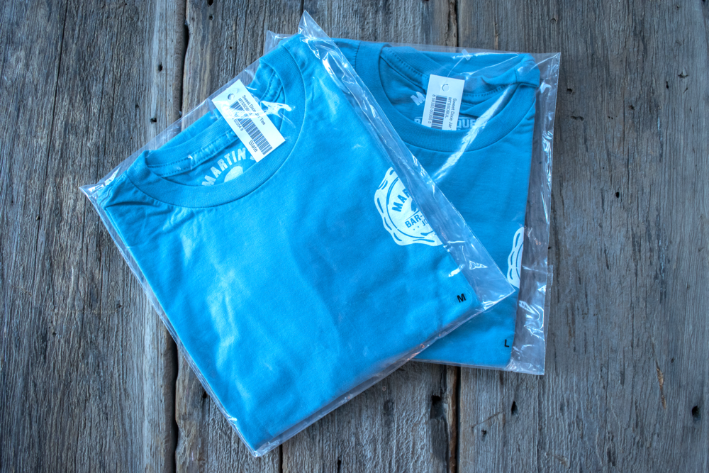 Having shirts folded and bagged makes them easy to organize and stock.