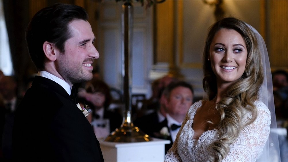 Phil and Emma make their vows to one another in the stunning ceremony room at Knowsley Hall. With light pouring in from the tall window at the front of the ceremony hall, Phil and Emma look absolutely stunning.