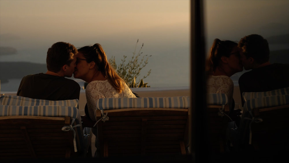 Sara and Gareth share a kiss in Santorini on the night before their wedding day.