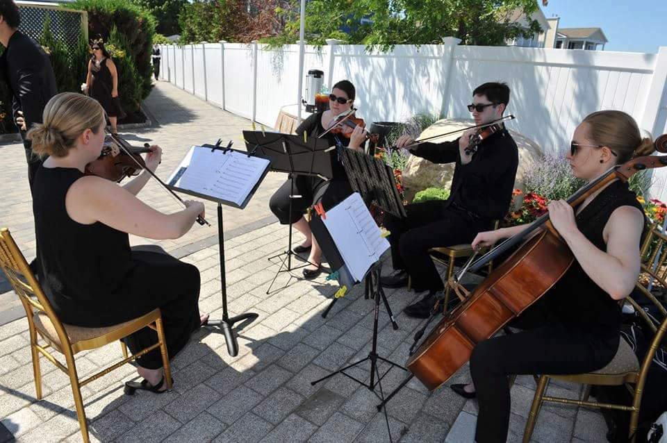 Illuminate String Quartet Catherine Colquhoun (violin), Neil Miller (violin), Kim Musial (viola) and Caleigh Drane (cello)