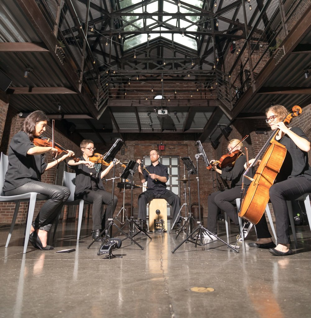 The Illuminate String Quartet - Our modern string quartet is comprised of two violinists, one violist, one cellist, and percussion. Our repertoire includes current Top 40 pop songs, hits from the 80s and 90s, as well as classic oldies. Upon request, our quartet will also mix in traditional classical music.Most wedding clients hire the quartet to play both the ceremony and cocktail hour. We also offer the option to add a percussionist to your cocktail hour, adding energy and anticipation for the reception. For smaller, more intimate weddings, the Illuminate String Quartet can play throughout the evening. For private parties or corporate events, the Illuminate String Quartet can play for the cocktail hour or the entire event.