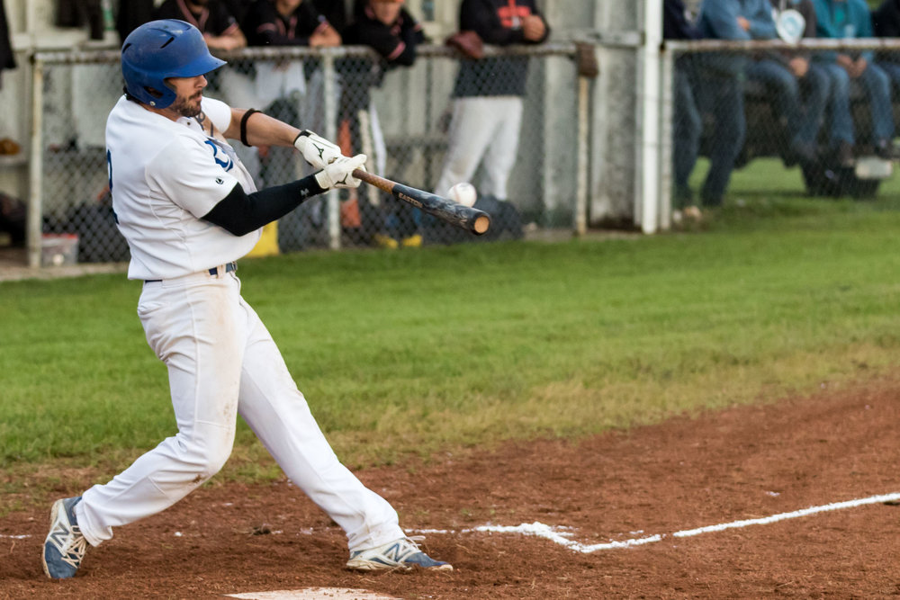 Armena Royals shortstop Jordan Hoover hits a three run home run in game three of the Powerline Baseball League Championship. The home run would be one of two for Hoover in the game | August 9 at Anniversary Park, Armena