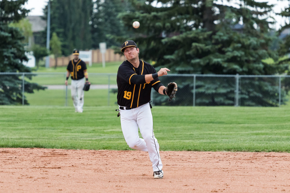 Edmonton Primeaus shortstop Kyle Fagnan throws across the diamond in a game versus the Camrose Axemen in North Central Alberta Baseball League action | July 13 at Harry Andreassen Field, Camrose