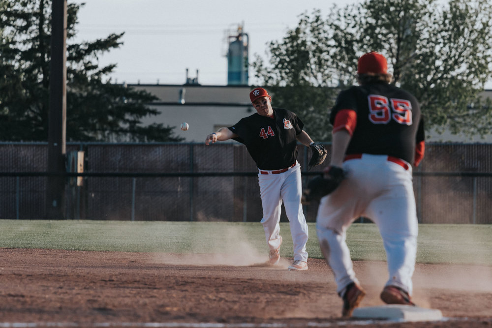 Camrose Axemen second baseman Ryan Petryshyn is in the process of throwing out an Edmonton Primeau hitter while first baseman Joe Pasychnyk sets up at the bag | May 17 at John Frye Park, Edmonton