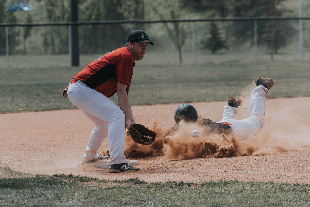Game one of the 2016 Camrose Axemen season saw Blair Mulder kick up a dust storm sliding head first into third base against the Edmonton Athletics in the top of the first inning. | May 8 at Footz Field, Edmonton