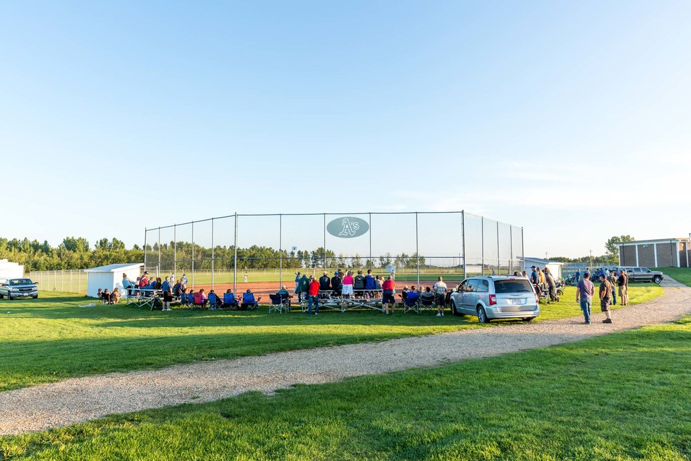 The small village of Rosalind played host to game two of the Powerline Baseball League Championship this season as their Athletics took on the Armena Royals. The small ballpark affectionately known as 'the Homer Dome' due to it's small field dimensions is home to baseball fans in the area | August 4 at Rosalind Ballpark