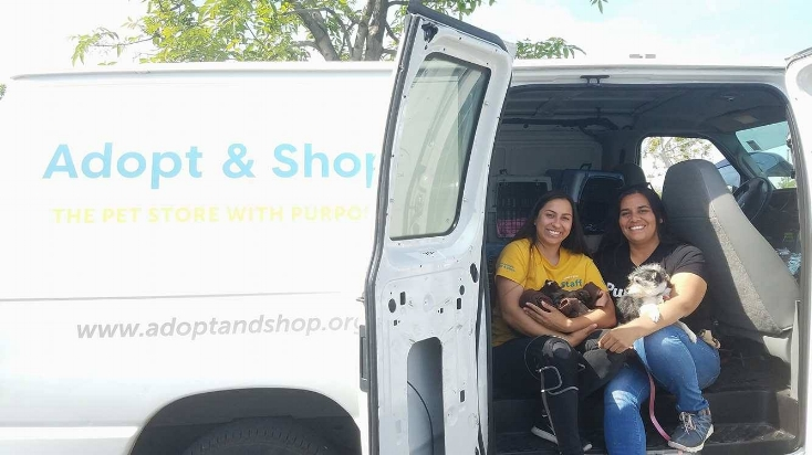 Jackie and Mila with one of our Pack Partners, sending dogs from a hoarding case to Adopt & Shop.