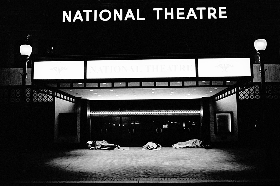 Homeless people sleeping at the National Theatre, a national landmark, located only few blocks away from the White House.  November 2004.  © Kike Arnal