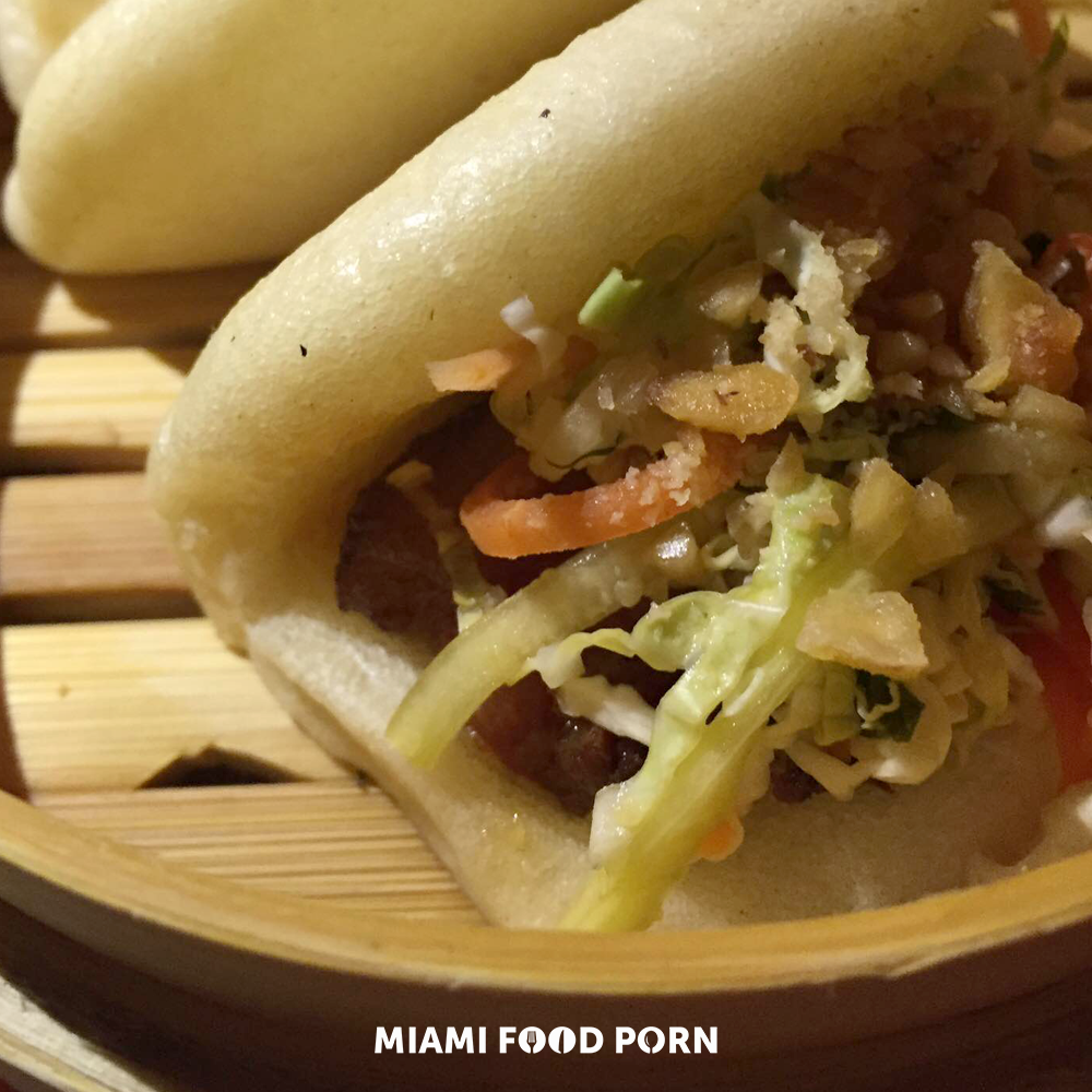 Pork belly bacon steamed buns with cilantro peanut slaw