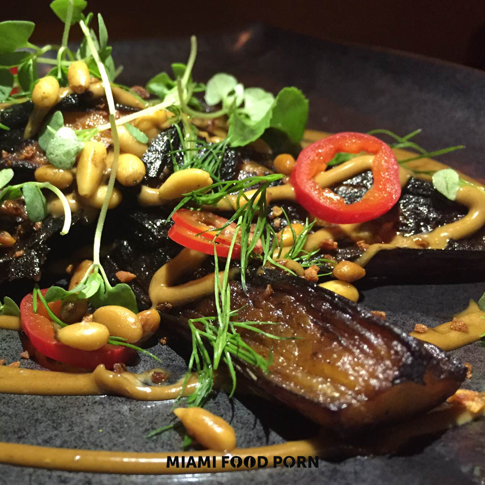 Grilled graffiti eggplant with black garlic aioli, tarragon, basil & pine nuts