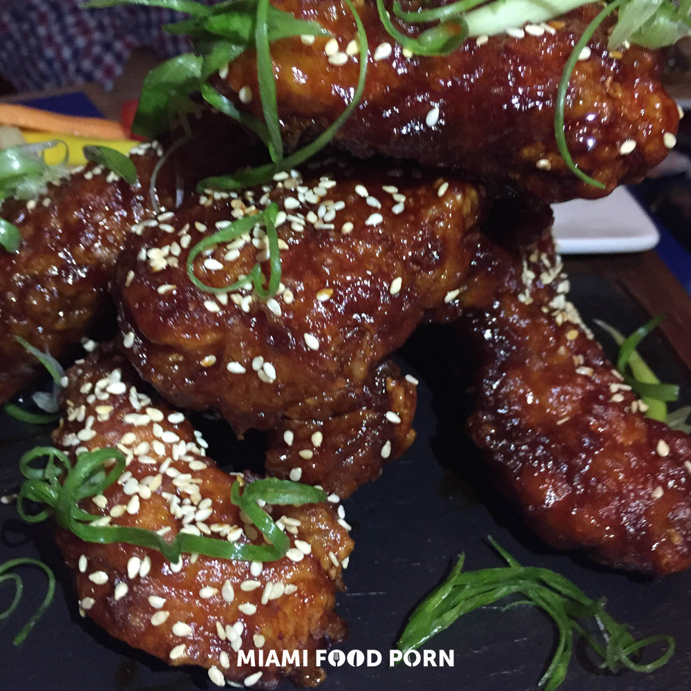 Korean Fried Chicken with spicy soy-garlic lacquer, pickles.