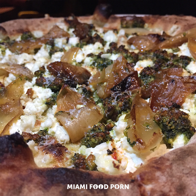 Pistachio Pesto Pizza with house made ricotta, charred onion and pecorino