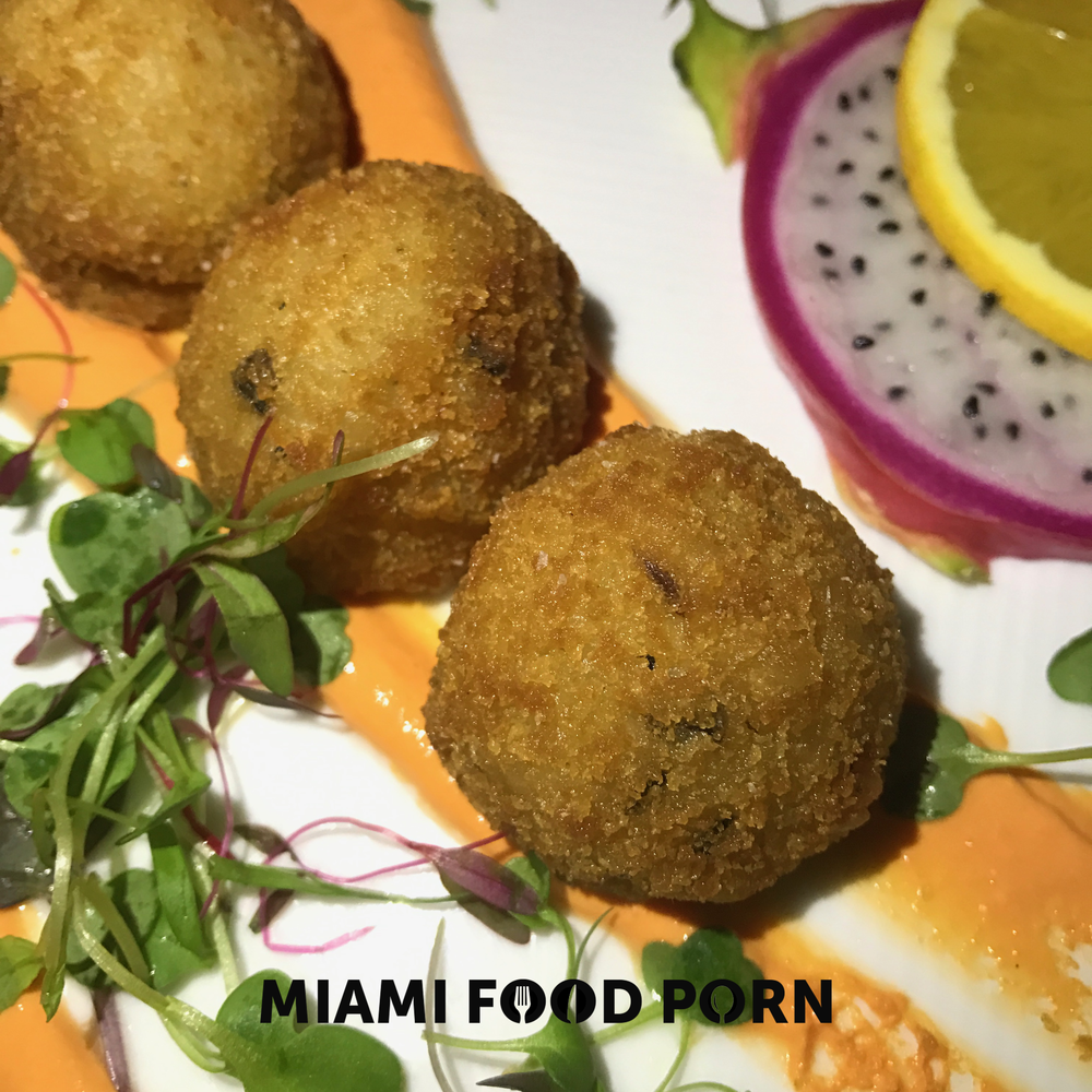 White truffle arancini with red pepper crema
