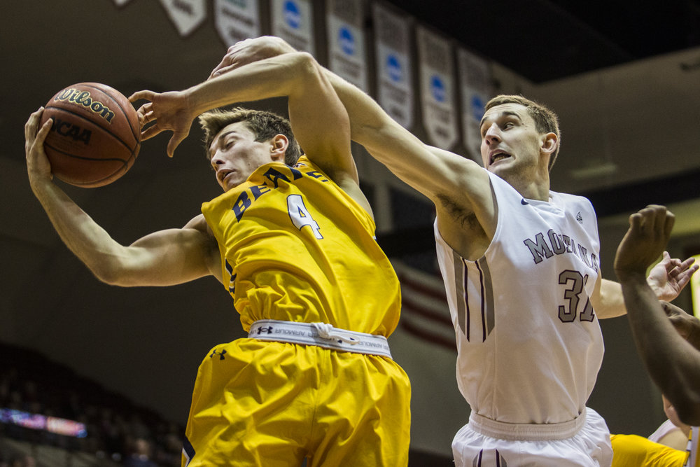 Griz guard Jack Lopez blocks a shot attempt by Northern Colorado guard Tyler Loose during the game at the Dahlberg Arena on March 5, 2016.