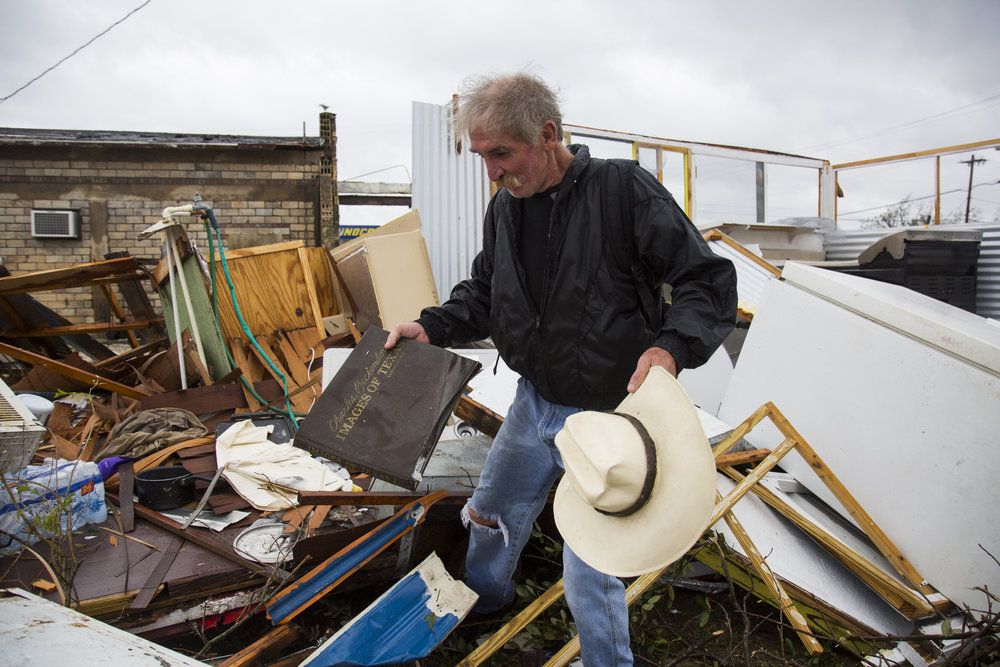 Harold Nubles, 54, searches through what is left of his barbecue truck in Refugio, Texas that was destroyed by Hurricane Harvey on Aug. 26, 2017.