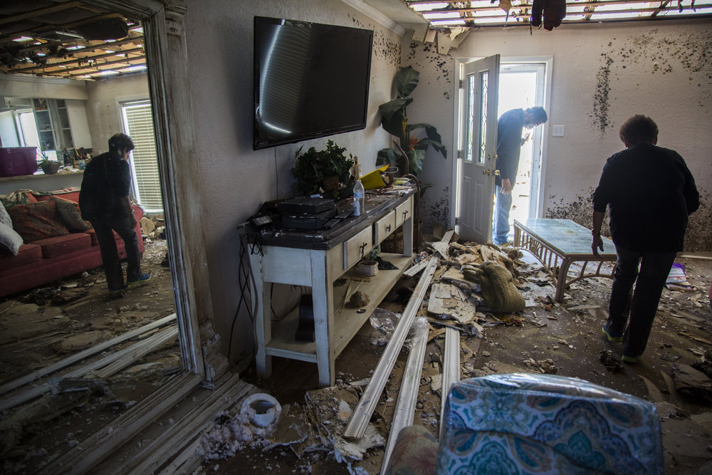Fred Gonzales, 76, and his wife Louise Gonzales, 78, move a salvageable table from their home in the Key Allegro neighborhood of Rockport that was destroyed by Hurricane Harvey.