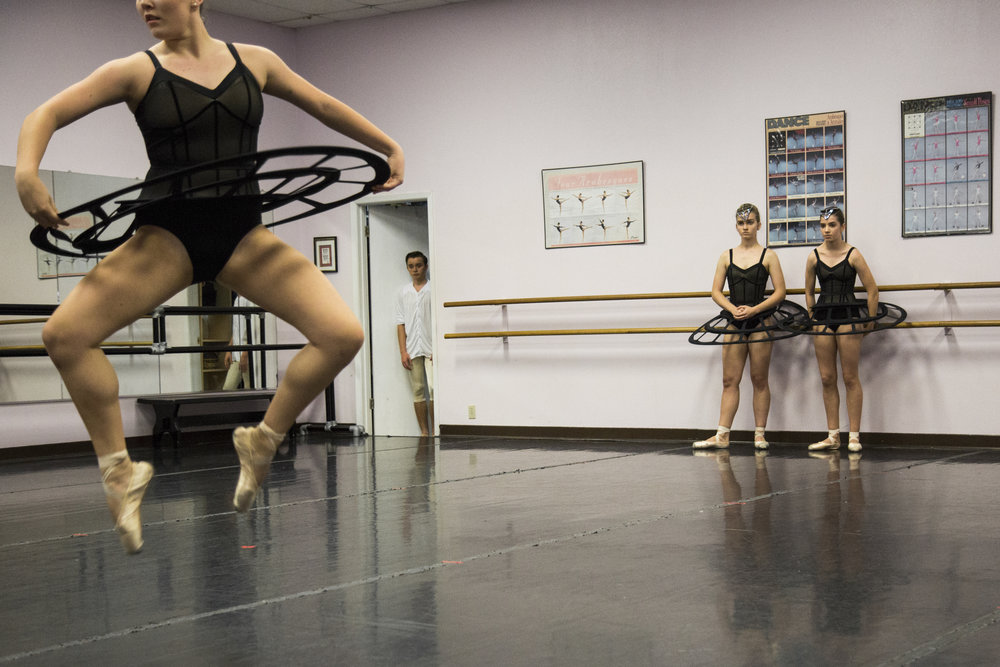 """Kyle Haschke, 16, center, watches from a doorway as Victoria Ballet Theatre dancers rehearse their fall piece, """"sub/merged"""" at the Busby Dancenter in Victoria, Texas on Sept. 23, 2017."""