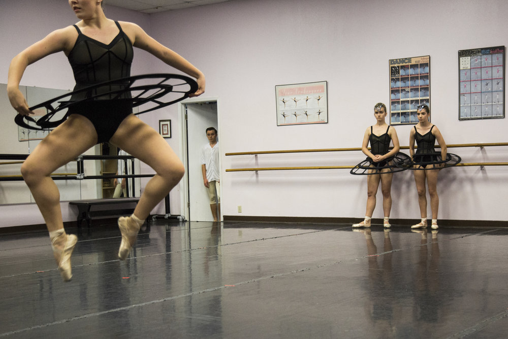 """Kyle Haschke, 16, center, watches from a doorway as Victoria Ballet Theatre dancers rehearse their fall piece, """"sub/merged"""" at the Busby Dancenter."""