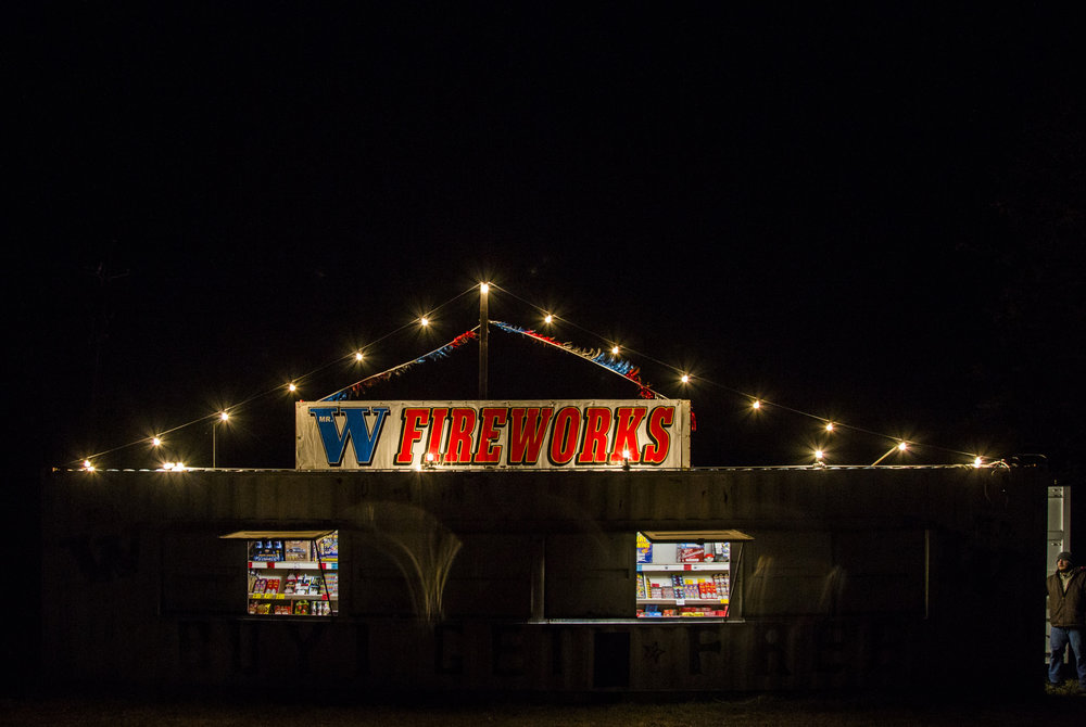 Eli Milner, 21, stands in the doorway of Mr. W Fireworks set up off of U.S. 59 just outside Victoria, Texas on Dec. 28, 2017.