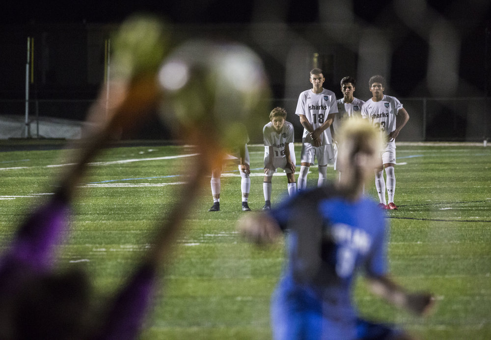 Gulf Coast players watch as their keeper blocks a penalty shot during the Class 4A regional final at Gulf Coast High School in Naples, Fla. on Wednesday, Feb. 14, 2018.