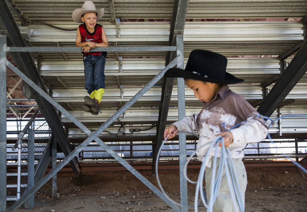 Brace Miller, 6, left, watches as Koty Gopher, 6, right, practices his roping before the start of the youth events during the Junior Cypress Memorial Rodeo at the Junior Cypress Rodeo Arena in Clewiston, Fla. on Saturday, March 17, 2018.