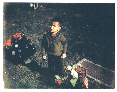 Ron at about two years old, next to his father's grave.
