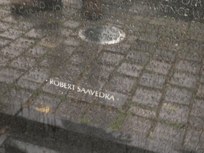 At The Wall, Robert Saavedra, Margaret's father. Sons and daughters of those who died in Vietnam are able to wash The Wall on Father's Day. When you rub a name after it's been washed, it emerges like this. Pretty amazing.